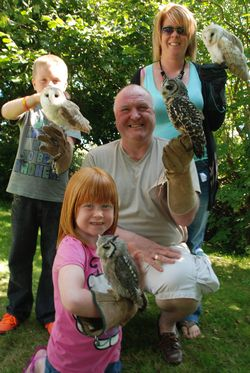 a family enjoying the exprience of meeting Owls-4-u